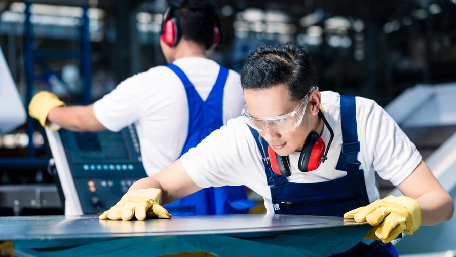 Manufacturers Working Safely Wearing Safety Goggles