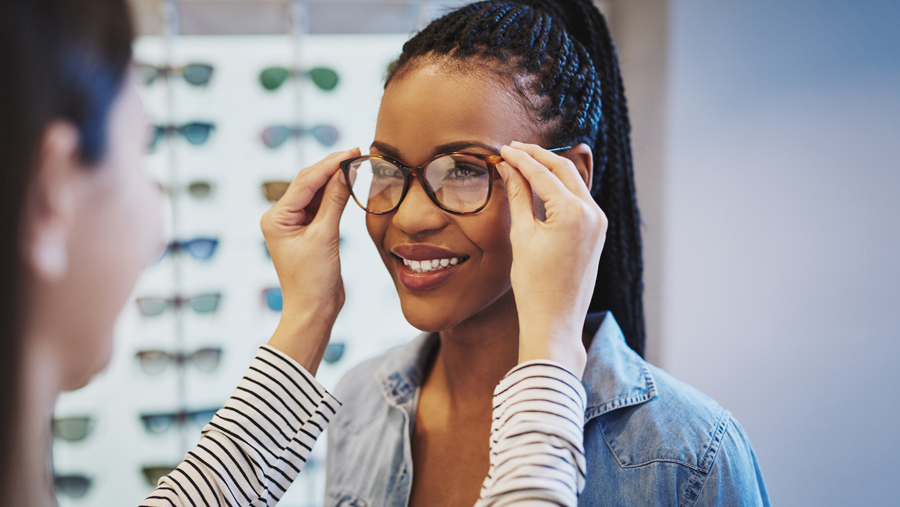Smiling Woman Trying on New Glasses