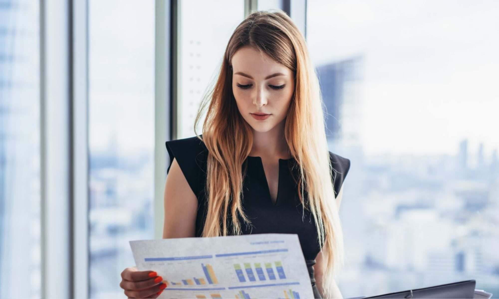 Female tax analyst reviewing risk data charts