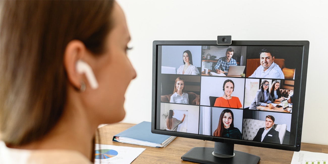 Young female employee hosting video conference with team